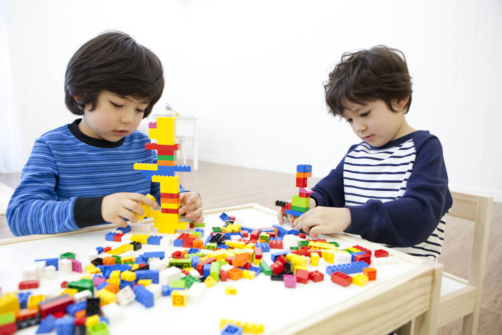 kids-entertained-at-home-playing-lego