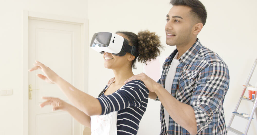 Virtual Field Trips - Man guiding little girl who is wearing VR glasses