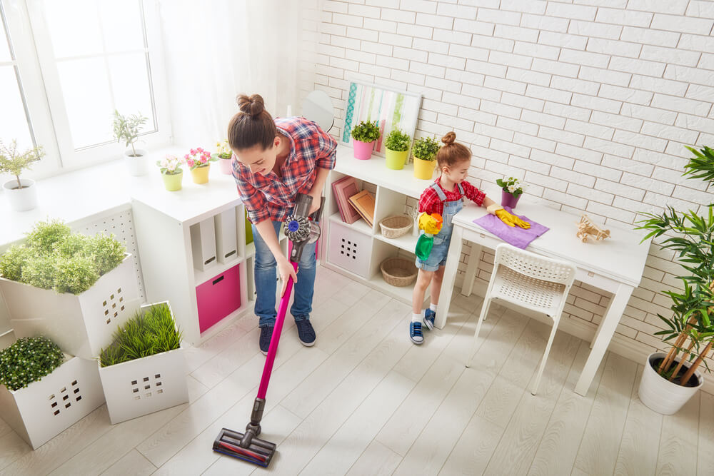 creative chores for kids - mom and daughter cleaning a room