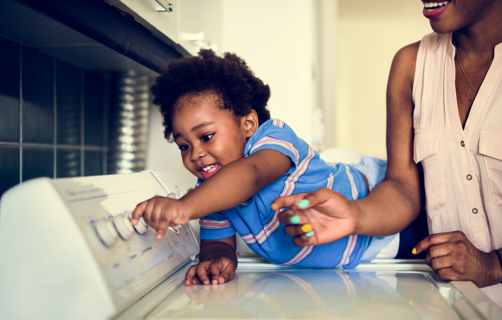 creative chores for kids - mom and son doing laundry