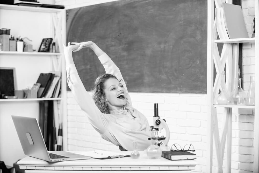 stress management for teachers - stretching female teacher in black and white filter