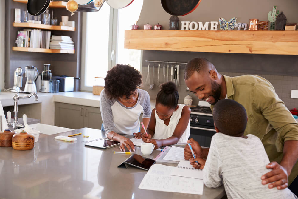 study for online tests - african-american family study together on table