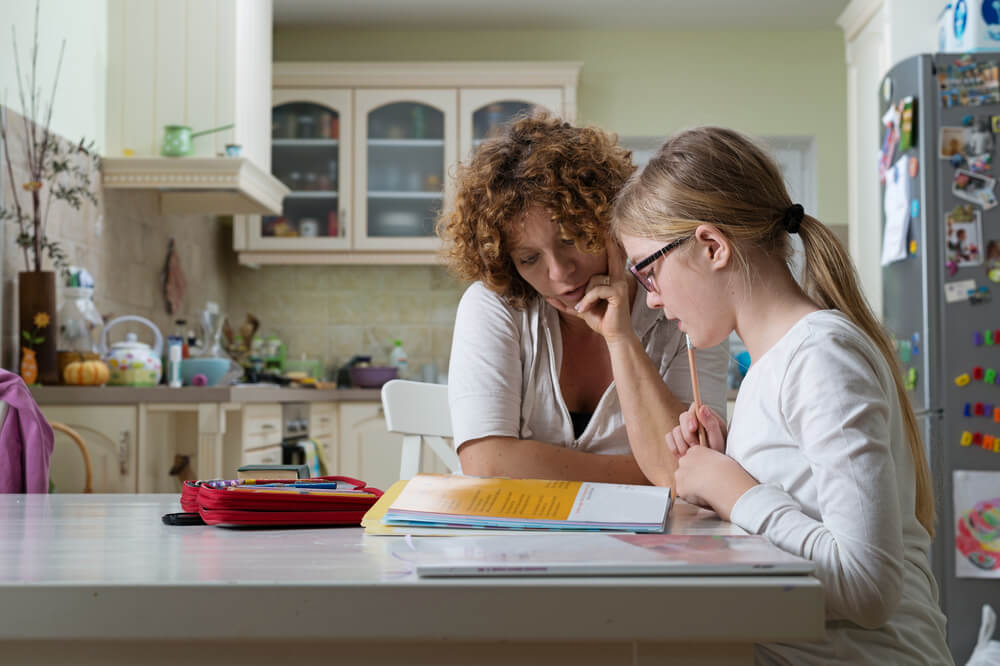 study for online tests - mom and daughter study for test