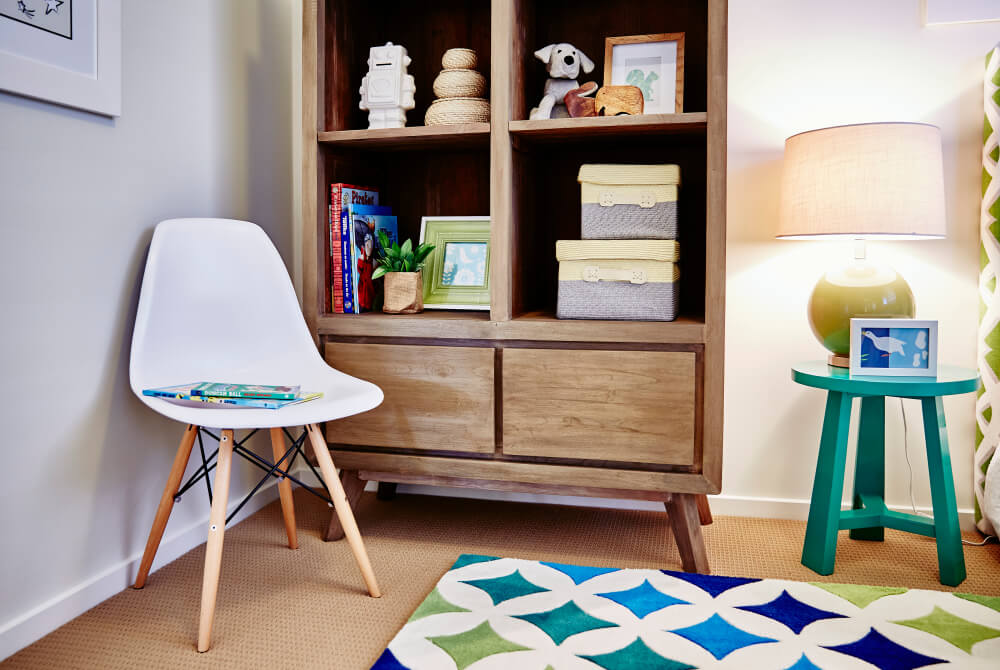 reading area for kids with bookshelf and chair