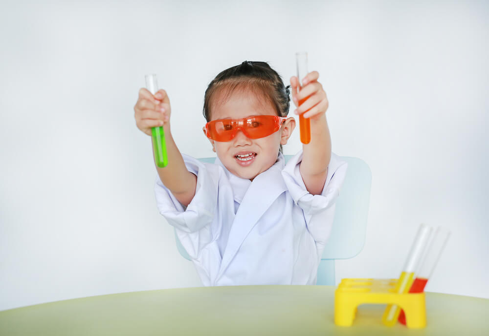 little girl playing science - learning disability activities at home