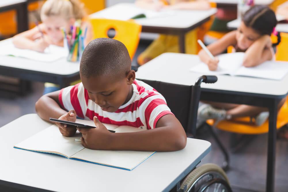 little boy on wheelchair in class