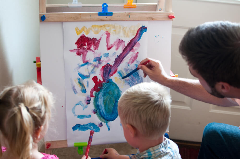 cover - homeschooling kids - dad painting with son and daughter