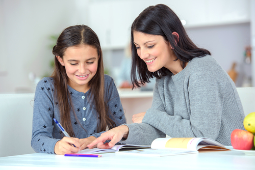 Mom helping her daughter do her homework