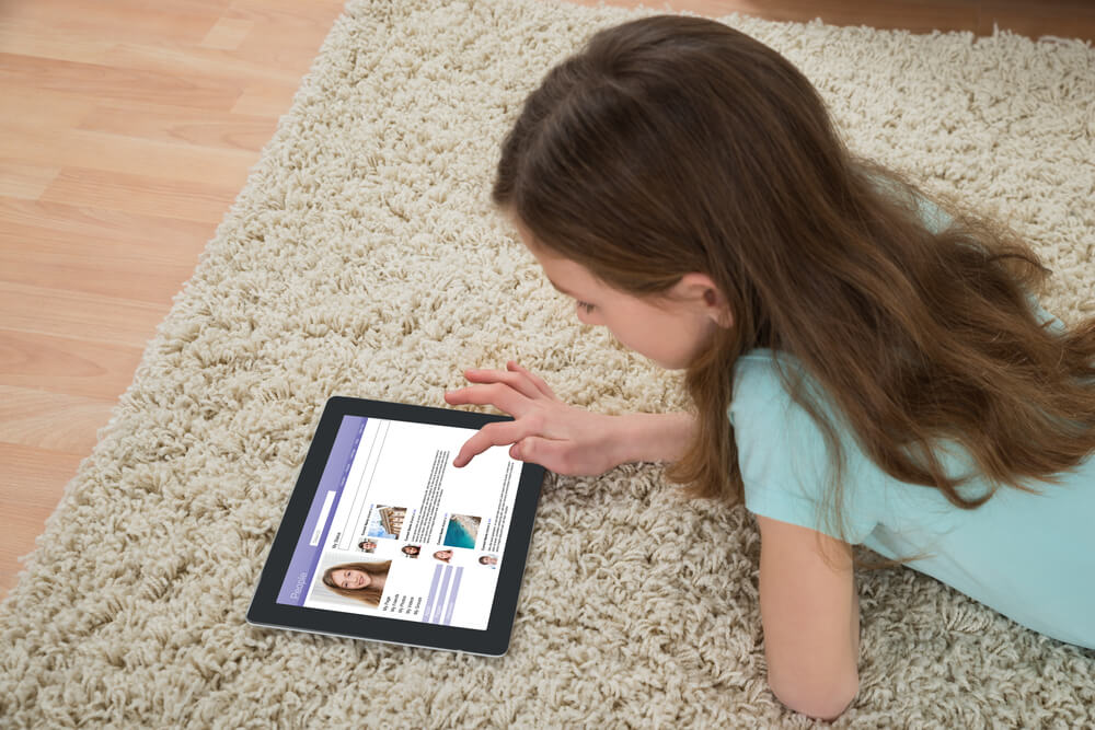little girl learning on tablet - kids mode