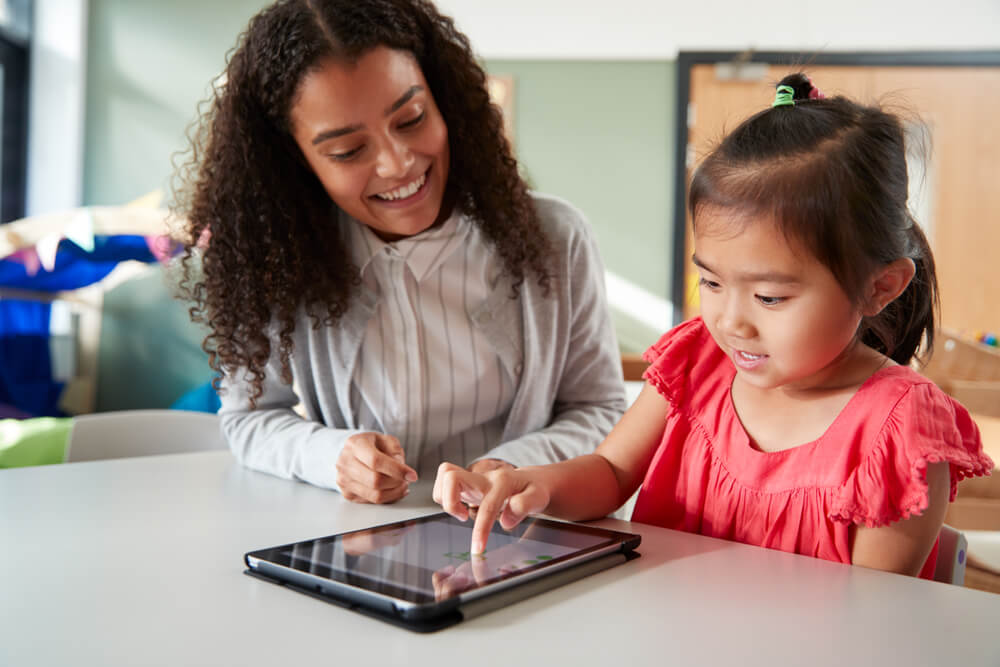 mom and child learning on tablet - kids mode